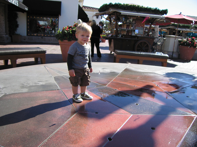 Owen at a spitting fountain