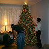Alex, Cory and Lori decorating the Christmas tree.  ( 2005 )