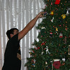 Cory decorating the Christmas tree.  ( 2005 )
