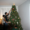 Lori, Cory and Alex are decorating the Christmas tree.  ( 2005 )