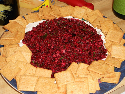 This in my new holiday tradition.  Fresh cranberries with jalapeno, cilantro, ginger, lemon juice over cream cheese!!  Amazing!