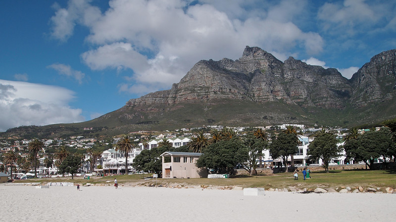 In the later afternoon sun, the beach affords nice views of the town of Camps Bay with Table Mountain in the background.