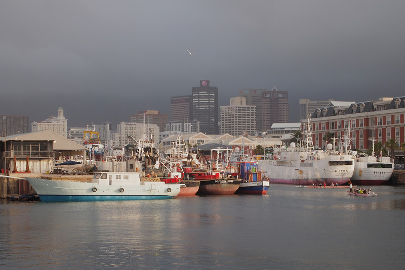 In the foreground, Chinese fishing boats.  In the background, a very rainy city centre.