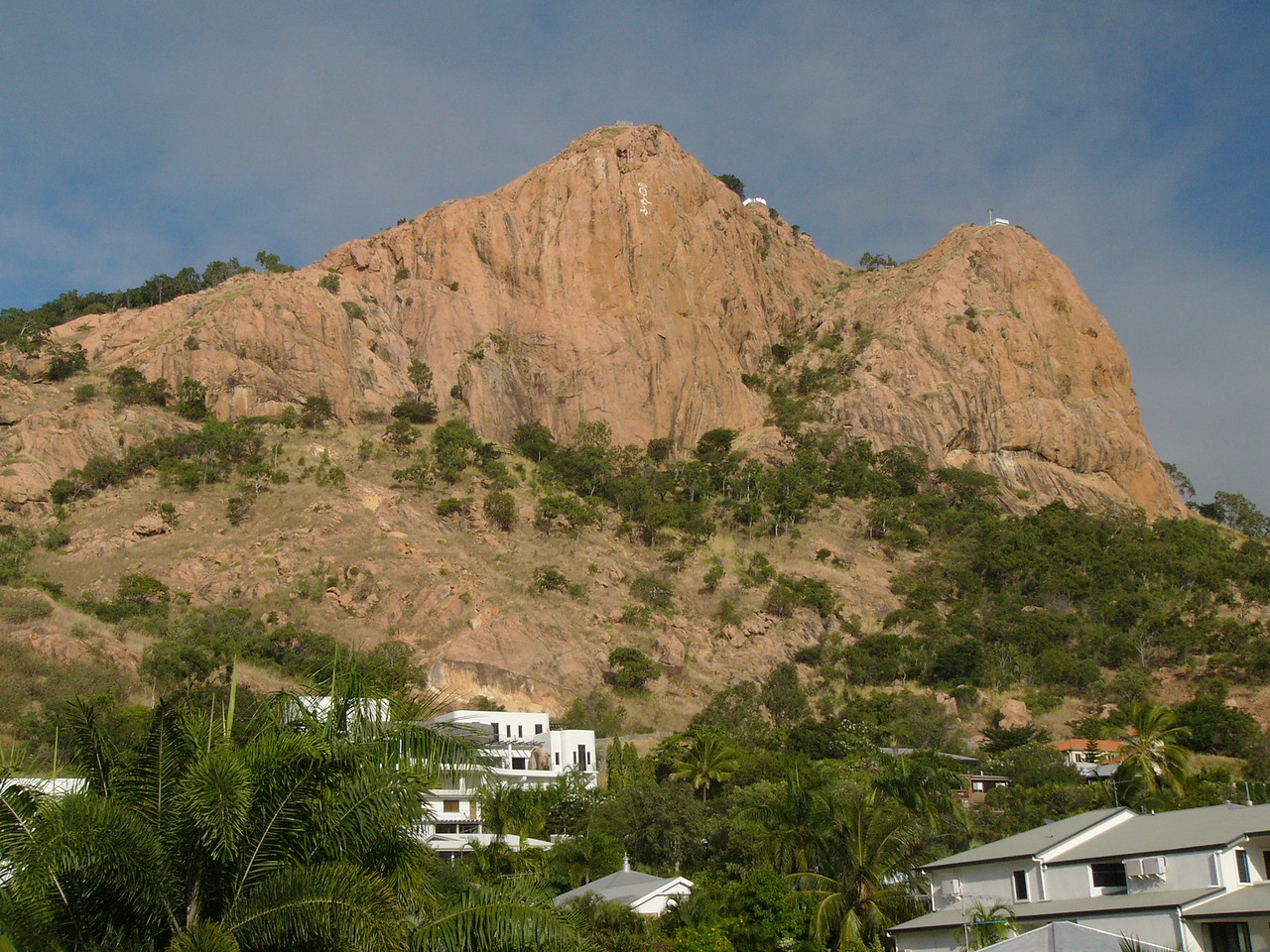 20070528_2846. Castle Hill, Townsville. The 'angel' on the side of the hill was originally a university prank. Following a town vote, it has been actively maintained (rather than removed!) ever since. There are several ways to walk up the hill, including the 'goat track' which runs along the ridge seen to the left of the peak. Alternatively, a taxi can be hired to get to the top.