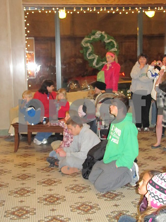 Children young and old enjoyed the warmth of in the lobby of the Wakonsa building and the beautiful carols provided by the two high school choirs.