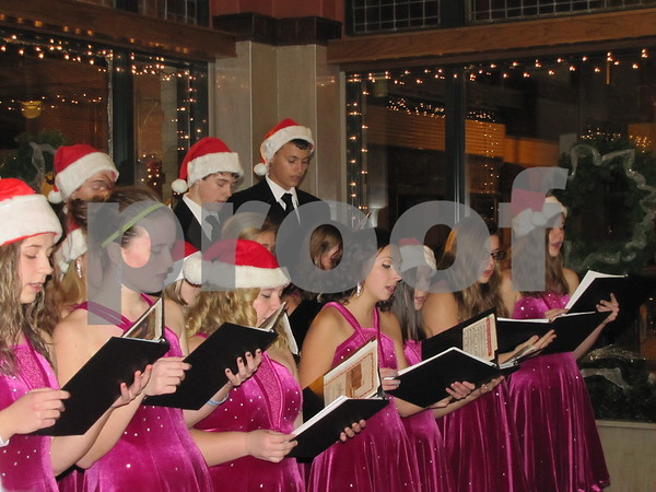 Members of the St. Edmond's choir sang carols to those in attendance at the Wakonsa building.