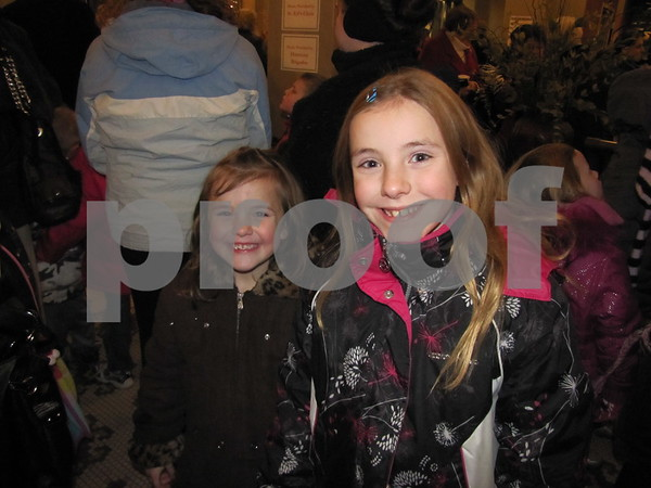 Arianna and Hunter Emch wait in line for a treat before going to visit Santa in the next room.