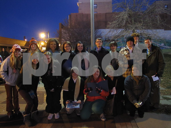 The 'Dodger Singers' from Fort Dodge Senior High were at the Tree Lighting Ceremony downtown. The group sang carols in the lobby of the Wakonsa after Santa's arrival.