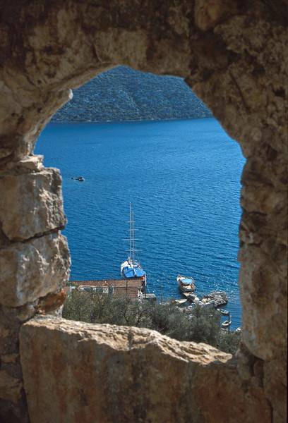 kalekoy - view of port through castle wall