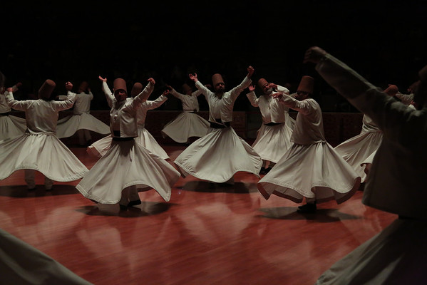In part four the dervishes drop their black cloaks and reveal white costumes. They are now considered  spiritually reborn to the truth.