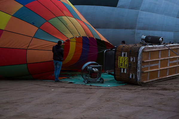 Tourists are being picked from the hotels and held inside cars a bit further until balloons are ready to fly.