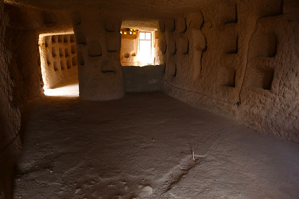 Holes in the walls were used as storage compartments. The volcanic rock is very soft so digging a house in it was convenient.