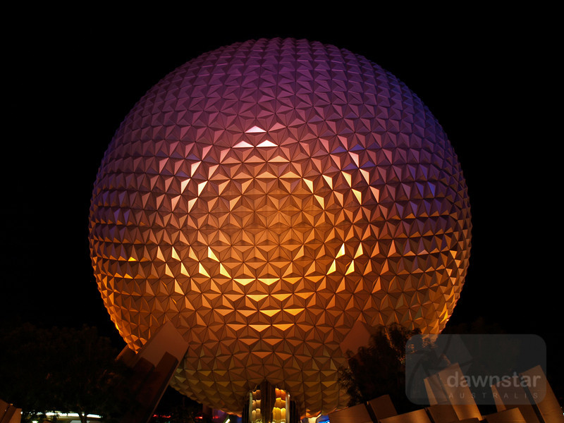 Spaceship Earth lit up at night