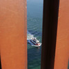 Tour boat heads under the Golden Gate Bridge