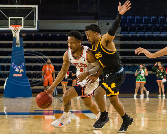University of Texas at Tyler's Jared Jenkins (3) pushes past  A&M-Commerce's Deon Barrett (1) during game action Saturday, Dec. 14, 2019, at the Louise Herrington Patriot Center in Tyler. (Cara Campbell/Tyler Morning Telegraph)