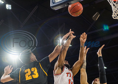 University of Texas at Tyler's Chris Giles (14) attempts a shot against A&M-Commerce during game action Saturday, Dec. 14, 2019, at the Louise Herrington Patriot Center in Tyler. (Cara Campbell/Tyler Morning Telegraph)