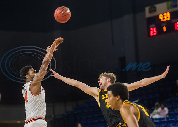 University of Texas at Tyler's Jerekius Davis (4) attempts a shot as an A&M-Commerce defender goes up to block during game action Saturday, Dec. 14, 2019, at the Louise Herrington Patriot Center in Tyler. (Cara Campbell/Tyler Morning Telegraph)