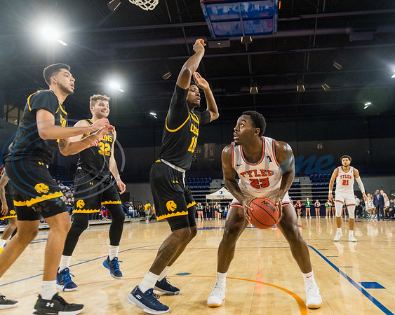 University of Texas at Tyler's Ansu Sesay (23) looks up before attempting a shot against A&M-Commerce during game action Saturday, Dec. 14, 2019, at the Louise Herrington Patriot Center in Tyler. (Cara Campbell/Tyler Morning Telegraph)