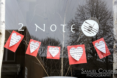 Hearts in the window of 2 Note
