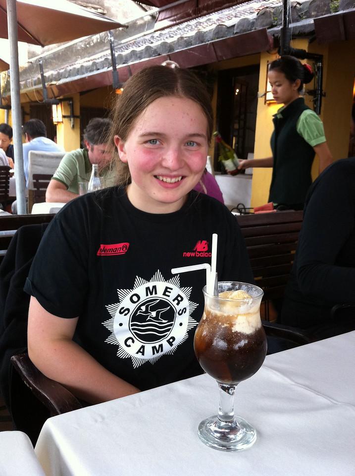 Matilda enjoying a decidedly Western refreshment
