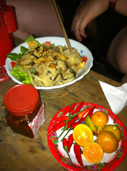 Our last meal in Hoi An: Cao Lau, a local specialty, from a street stall by the river. $4 for four of us, including two beers.