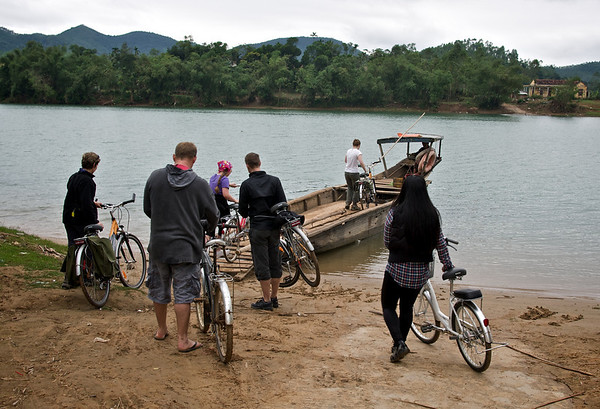 Bike and people ferry across the river: start of our bike tour to Phong Nha Cave