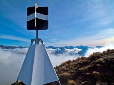 Roys Peak Trig with Mt Aspiring in background.