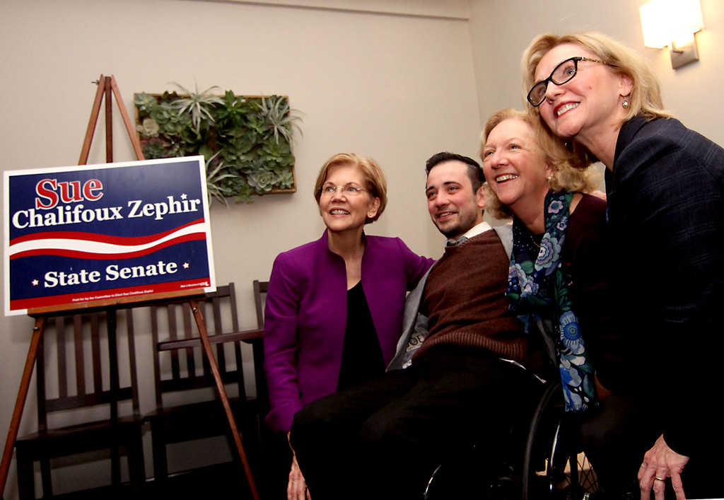 . Having a photo opp at campaign rally at Slattery\'s Restaurant in Fitchburg is L-R, Sen Elizabeth Warren, Nick Carbone, Beth Walsh, both from Fitchburg, and canadate Sue Chalifoux Zephir. SUN/David H. Brow