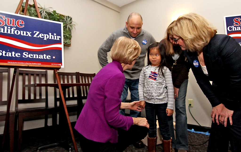 . Little 5 year old Ella Cerasuolo, has a high level meeting with Sen Elizabeth Warren, on left, and State Senate canadate Sue Chalifoux Zephir, on right, in back Ella\'s parents Christopher and Debra Cerasuolo of Westminster,Ma., at campaign rally held at Slattery\'s Restaurant in Fitchburg. SUN/David H. Brow