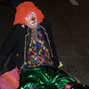 A clown who has had a bit too much takes a rest on the street during the West Hollywood Halloween Costume Parade 2009