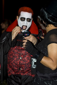 A man dressed in a scary Halloween costume touches up his makeup at the West Hollywood Costume Parade 10/31/2009