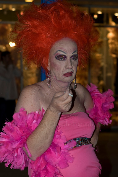 A man in a hot pink dress, hot pink feather boa and bright orange wig in the annual West Hollywood Custome Parade 2009<br /> Photo ©Laurie Paladino 2009<br /> All rights reserved