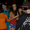 A man dressed as a Zorro type character eyes a young woman dressed as Wonder Woman at the West Hollywood Halloween Costume Parade 10/31/2009