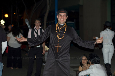 A smiling man dressed as a priest celebrates Halloween at the West Hollywood Halloween Costume Parade in West Hollywood, CA 10/31/2009