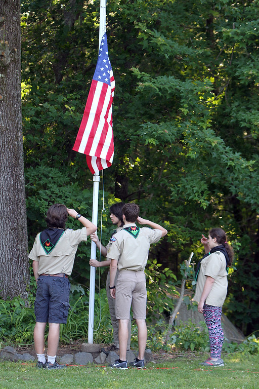 . Flag retirement ceremony for Flag Day at Nabnasset American Legion Post 437 in Westford.  Members of Boy Scout Troop 437, from left, Ian Anderson, Max Mazgalis (rear), Ben McQuinn and Mairead Catalano-Foley, raise a new flag. (SUN/Julia Malakie)