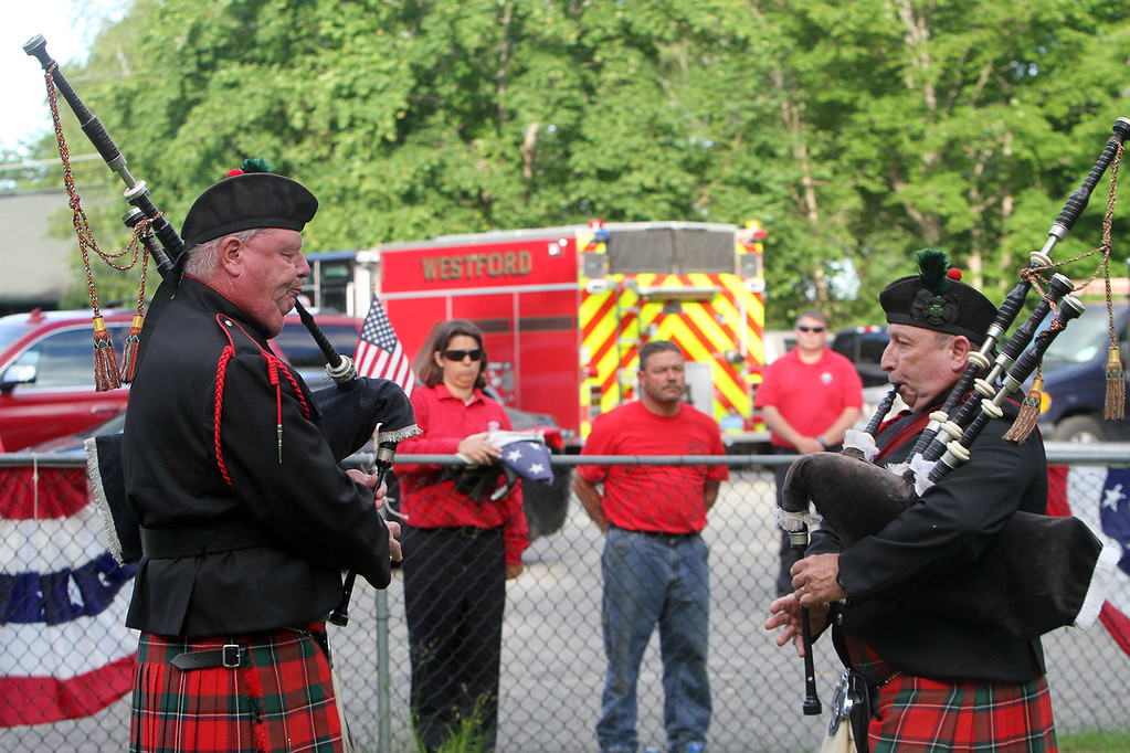 . Flag retirement ceremony for Flag Day at Nabnasset American Legion Post 437 in Westford. Westford F.D. Lt. Donald Parsons, left, and Winchester F.D. Capt. Rick Tustin, members of the Westford District Pipes & Drums, play bagpipes.  (SUN/Julia Malakie)