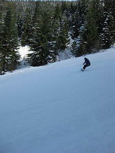 Adam Snowboarding down the Hill