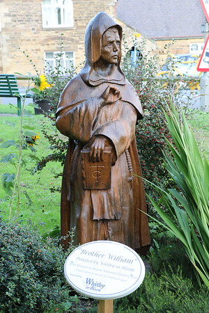 Wooden carving of Brother William