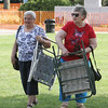 Madeline Bimbo, left, and Dot Cunha, both 49-year residents of Wilmington, head for their spot on Town Common for a pre-4th of July concert. (SUN/Julia Malakie)