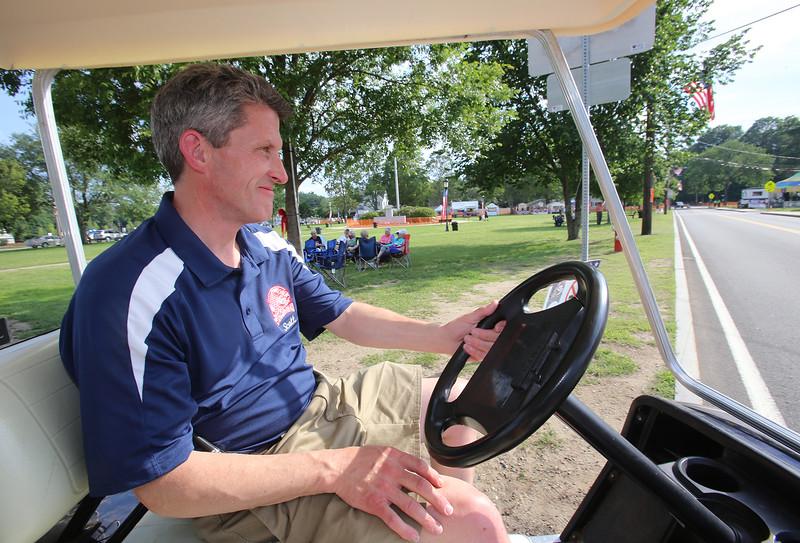 Wilmington 4th of July Committee chair, and volunteer, Scott Garrant of Wilmington, prepares for start of weekend's activities. (SUN/Julia Malakie)