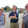 Wilmington 4th of July Committee chair, and volunteer, Scott Garrant of Wilmington, prepares for start of weekend's activities. Scott Garrant, center, talks with former committee members Phyllis and husband Joe Vieira, formerly of Wilmington, now of Tewksbury. (SUN/Julia Malakie)