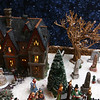 Dickens Christmas village, at the home of Andy Dufour and his wife Sandy Dufour in Windham, N.H. Dufour bought the tree at rear, and others from a company that makes model bare deciduous trees from actual trees' roots. (SUN/Julia Malakie)