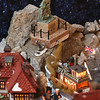 Dickens Christmas village, at the home of Andy Dufour and his wife Sandy Dufour in Windham, N.H. Dufour works a model of the Gloucester Fisherman's Memorial into a section of his Dickens village. (SUN/Julia Malakie)