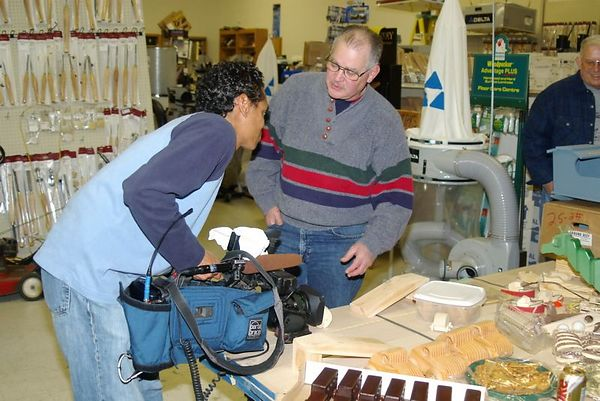 "<font size=""3"">Camera man from local TV station takes a closeup of a ""tumblebug"" toy in action. </font><br>Return to <a href=""http://www.omahawoodworkers.com/"">Woodworkers Guild</a><br>"
