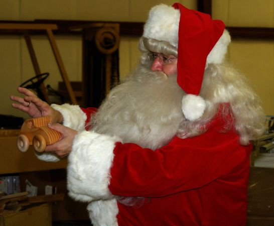 "<font size=""3"">Santa tells the woodworkers how some of the hospitalized kids may need to grasp a toy. </font><br>Return to <a href=""http://www.omahawoodworkers.com/"">Woodworkers Guild</a><br>"