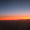 flying into the sunset; Rockies are on horizon in distance.  An endless Christmas Eve.