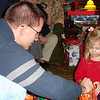 Daddy helping Madison open present 12-18-04
