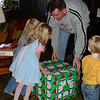 Daddy handing out gifts to the deliverers 3 12-17-05