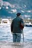 dubrovnik - man fishing at old harbour