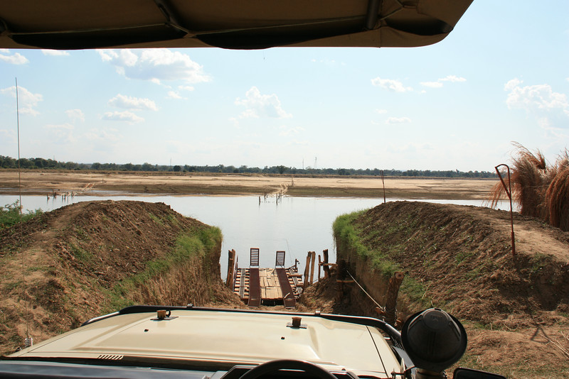 Our entry into South Lwanga National Park:<br /> Open top truck and a ferry, African style, across the river.